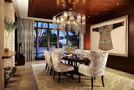 View In Gallery Chandelier And Wall Art Bring Opulence To The Beautifully Lit Dining Room Design Mary
