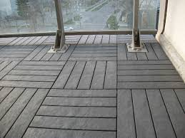 charcoal grey floor decking tiles on balcony floor we supply and