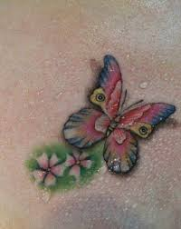 Butterfly Tattoo With Flowers And Water Drops Looks Very Beautiful