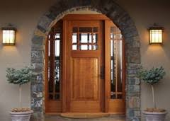 CUSTOM & MANUFACTURED DOORS — curved wood moldings Thomas