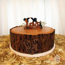 Rustic Cut Log With Carved Heart Sitting Buck Grooms Cake