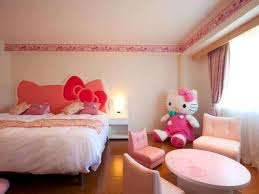 hello kitty bedroom with hello kitty headboard and doll creating