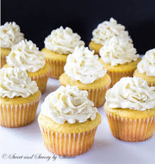 These are deliciously light and soft vanilla bean cupcakes topped with sky high silky