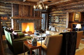 Decorative Pillows In Rustic Living Room With Green Leather Club Chair And Couch Also Log Cabin Round Chandelier Plus Throw