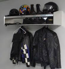 Motorcycle Storage And Riding Accessory Including Wall Enclosed Trailer Rack