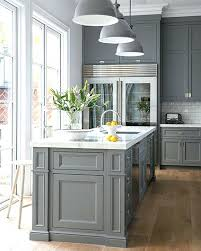 light grey kitchen cabinets with countertops black counters