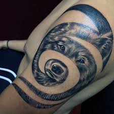 Awesome Spiral Tribal Wolf Tattoo On Left Shoulder