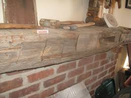 Let Me Build You A Barn Beam Mantle! | I Also Live On A Farm Hand Hune Barn Beam Mantel Funk Junk Relieving Rustic Fireplace Also Made From A Hewn Champaign Il Pure Barn Beam Fireplace Mantel Mantels Wood Lakeside Cabinets And Woodworking Custom Mantle Reclaimed Hand Hewn Beams Reclaimed Real Antique Demstration Day Using Barnwood Beams Img_1507 2 My Ideal Home Pinterest Door Patina Farm Update Stone Mantels Velvet Linen