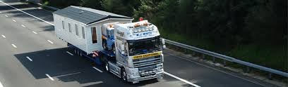 MJ White Haulage Caravan and mobile home transport and siting to