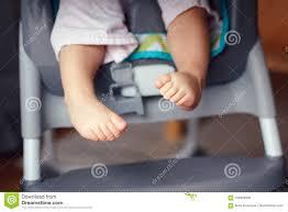 Chubby Baby Legs Feet. Small Kid Sitting In High Chair Stock ...