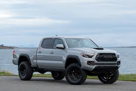 2018 Toyota Tacoma TRD Lifted Custom In Cement Grey Used Lifted 2017 Toyota Tacoma Trd 4x4 Truck For Sale 36966 Tacoma Lift Google Search Pinterest Pin By Mr Mogul On Trucks Marketing Media Why Buy A Muller Clinton Nj Single Cab Images Pinteres Pro Debuts At 2016 Chicago Auto Show Live Photos Tundra Stealth Xl Edition Rocky Ridge Toyota Ta 44 For Of 2018 Custom In Cement Grey Consider The Utility Package A Solid Work