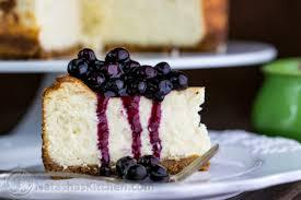 Velvety New York style cheesecake with an easy blueberry topping NatashasKitchen