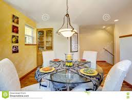 Interior Of Dining Room With Yellow Wall And Hardwood Floor ...