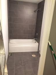 Lowe's Mitte Gray Tile 12x24 Bathroom Tub Surround And Floors Bath ... 62 Stunning Farmhouse Bathroom Tiles Ideas In 2019 7 Best Floor Tile Options And How To Choose Bob Vila Maximum Home Value Projects Flooring Hgtv Stone Architectural Design Buying Guide Small Bathroom Ideas Small Decorating On A Budget New Designs Pictures Trends Bathtub The Latest 59 Phomenal Powder Room Half Bath Shower That Reveal Materials For Job Top 10 Worst Your 50 Rustic Deocom