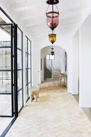 white hallway with glass coloured pendant lights white hallway