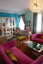 Teal Living Room Walls by Bright Colours Living Room Teal Wall Blue Wall Pink Couch