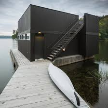 100 Boathouse Architecture Mu Completes Black Lakefront Home With Two