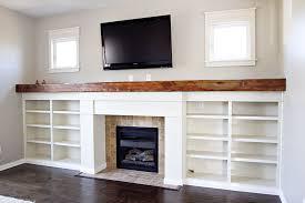 Custom fireplace surround bookshelves reclaimed wood mantle
