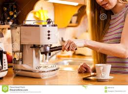 Download Woman In Kitchen Making Coffee From Machine Stock Image