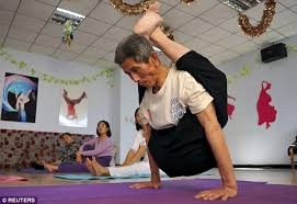 Agile Pensioner Hou Zhenshan Practices His Moves In A Community Centre While Younger People Look