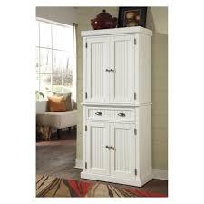 white beadboard texture free standing corner pantry cabinet in