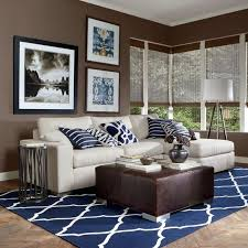 Modern Brown And White Living Room With Navy Pillows A Carpet