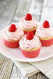 Gluten Free Vegan Raspberry Vanilla Cupcakes Fluffy vanilla cupcake topped with a fresh raspberry