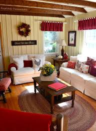 Mesmerizing Farmhouse Living Room Decor Vintage Beige Stripes Wall Red Valance Brown Wooden Table White Couches