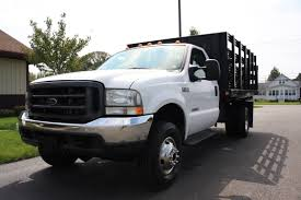 Flatbed/Landscaper Trucks From Russell's Truck Sales 2004 Intl 4300 16 Flatbed Truck For Sale Youtube Med Heavy Trucks For Sale Intertional Trucks In Tennessee For Used Bucket Reliable Bts Equipment 1970 Gmc 13 Ton Flatbed In Pa Used 2013 Freightliner M2106 Truck New Mitsubishi Fuso 7c15 Httputoleinfosaleusflatbed 1977 Chevrolet C65 Flatbed Truck Item Dc53 Sold Octob Ford Georgia On Maun Motors Self Drive Flat Bed Van Hire From