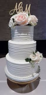 3 Tier Rustic Textured Buttercream Wedding Cake Decorated With Fresh Flowers Cakes At The
