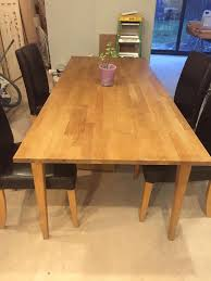 ikea solid oak large table with 4 ikea henriksdal leather chairs