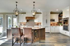 French White Kitchen Beautiful Country With Cabinetry Hidden Door Refrigerator Vinyl Plank Floors