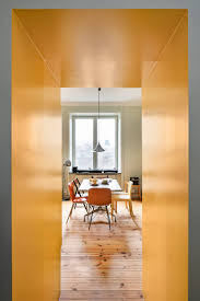100 Walls By Design Storage Walls Define Space Within Bright Yellow Apartment In Stockholm