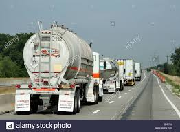 A Line Of Trucks On A Highway, Crown City, United States Of America ... Crown Internal Combustion Lift Trucks Royal Mini 55 Standard 1 Pair Raw 85 3302_toyotacrowns40pickup Toyota Pickups Pinterest Race Black Std Skateboard 50 Skatewarehouse Counterbalanced Forklifts Youtube Opening Hours 30 Hanna Crt Beville On Electric Walkie Pallet Stacker M Equipment Tsp 6000 Series Vna Turret Truck Rawteal 525 Forty Two Shop A Line Of Trucks On A Highway City United States America Crownforklifttrucksblogaug18 Phl