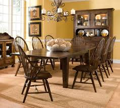 Small Rustic Farmhouse Dining Room Design With DIY Custom Expandable Large Wooden Table And 8 Chairs Under Old Black Iron Hanging Chandelier Ideas