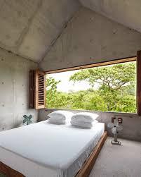 schlafzimmer aus holz und beton mit bild kaufen