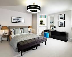 Lavish Bedroom Decor With Comfortable Yet Stylish Bed Next To Glossy Black Desk And Cute Blue
