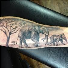 African Elephant Full Sleeve Tattoo With Hints Of Colour To Bring Out Some Detail