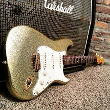 Picture Of Gold Flake Finish A Guitar