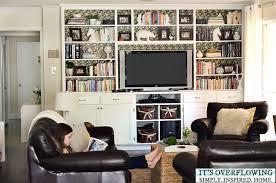 simple decorating bookshelf its overflowing