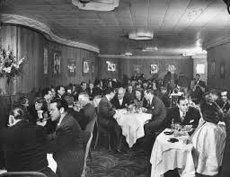 bureau vall馥 bethune the stork actor orson welles at table on left along w