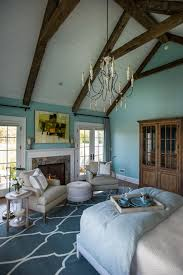 Cathedral Ceiling Bedroom With Green Wall Paint And Wood Loft