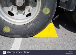 Yellow Wheel Chock Wedge Under Truck Tyre Stock Photo, Royalty ... Goodyear Wheel Chocks Twosided Rubber Discount Ramps Adjustable Motorcycle Chock 17 21 Tires Bike Stand Resin Car And Truck By Blackgray Secure Motorcycle Superior Heavy Duty Black Safety Chocktrailer Checkers Aviation With 18 In Rope For Small Camco Manufacturing Truck Bed Wheel Chock Mount Pair Buy Online Today Titan Wheels Gallery Pinterest Laminated 8 X 712