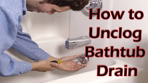 Unclogging A Bathtub Drain Video by How To Unclog A Bathtub Drain With Standing Water Naturally
