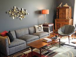 grey wall theme and grey fabric sofa also rectangle brown wooden