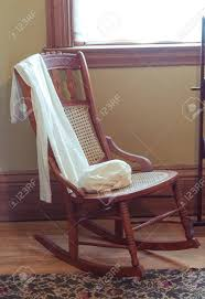 Old Wooden Rocking Chair In A Room Sussex Chair Old Wooden Rocking With Interesting This Vintage Wood Childs With Brown Rush Seat Antique Child Oak Windsor Cane And Back Rocker Free Stock Photo Freeimagescom 1830s Life Atimeinlife Amazoncom Kid Rustic Kids Indoor Chairs Classic Details That Deliver Virginia House Cherry Folding Foldable