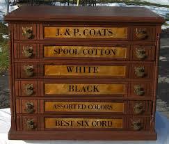 j p coats 6 drawer spool cabinet with brass pulls brass lantern