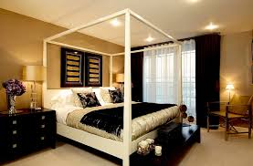View In Gallery Wallpapered Walls Gold And Black Decor Throws Give The Master Bedroom A Luxurious Look