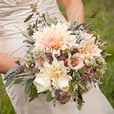 A Rustic Romantic Bouquet Of Dahlias And Roses
