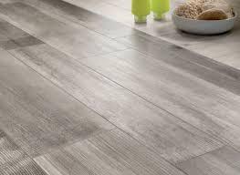 medium grey tile looks like wood new basement and tile